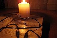 Свеча, очки, книга