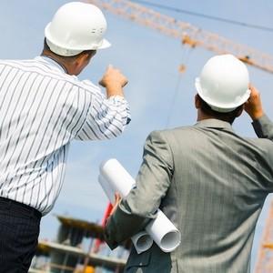 строители