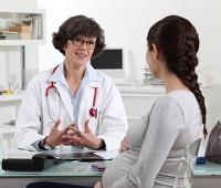 Беременная на приеме у доктора